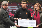 Cristiano Ronaldo presenting the ICRC with cheque for fundraising campaign on 9 April 2008 in Manchester. , http://www.icrc.org/eng/assets/images/other/682133_w2_m.jpg