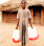 A Rufiji farmer's daughter carries a chicken feeder and drinking system