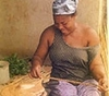Ghana_woman-making-jeweller125x110_tcm13-141046