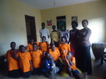 Some of the AIDs orphans with 3 guardians on the left and 2 staff on the right
