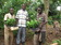 Beneficiaries accepting coffee seedlings from one of the founding directors of Eriro Foundation