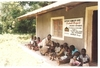 Suhog_project_jared_distributing_juice_to_the_children