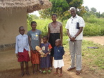 Moses Okeng The Director HOWCA,barbra ageno(a widow), and Her children at their home in Lira