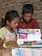 Orphan Children reading books which were given them by Rev.Matthew Suroya.
