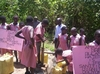 Holy cross children collecting water