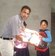 Rev .Suroya Giving Educational Material to Poor Child.