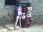 giving books to children by  ABANG ASHU ACADEMY C.I.G