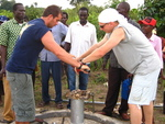 Drilling a borehole in the community.