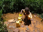 A 5 yr old fetching contaminated water for domestic use
